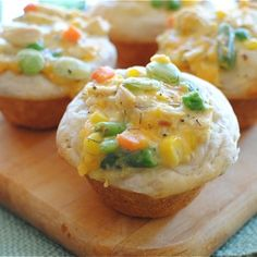 Chicken Pot Pie Cupcakes. Press biscuits in cupcake tins. Mix chicken, cream of chicken soup, chicken broth, cheese, veggies and spices in a bowl. Bake