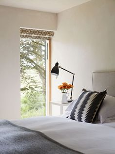 Roller blinds with a hood provide a contemporary solution to window treatments in this treetop house Devon House, Monochrome Bedroom, Roller Blinds, Window Treatments, Windows, Contemporary, Home Decor, Homemade Home Decor, Roller Shades