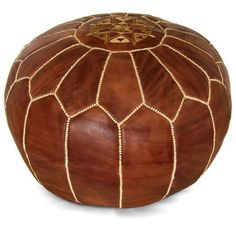 Handmade leather pouf with a medallion design. Product: PoufConstruction Material: Genuine leather and shredded foam fillColor: BrownFeatures: HandmadeCan be used as an ottoman or extra seating Dimensions: 12 H x 21 Diameter Moroccan Pouffe, Moroccan Leather Pouf, Leather Pouf Ottoman, Ottoman Footstool, Ottomans, Brown Ottoman, Blue Ottoman, Leather Sofa, Leather Bags