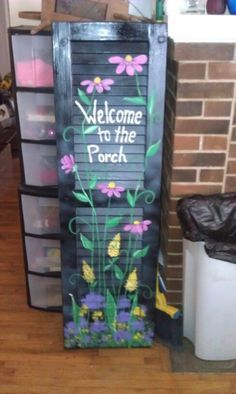 Hand painted shutters...I love taking something old like this shutter and turning it into something fun for the porch.Carla's Simple Gifts & Floral,  Independence kansas