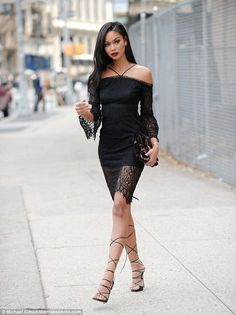 Chanel Iman looked sensational as she stepped out in New York City on Tuesday. The 26-year-old fashion model wore a high neck black lace dress and a black teddy bear style coat.