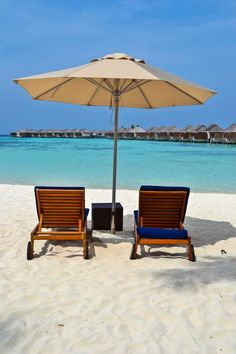Beach chairs at the W Maldives with a perfect view of the overwater bungalows and turquoise lagoon. Where Is Maldives, Maldives Beach, Ocean Beach, Maldives Islands, Maldives Travel, Vacation Places, Vacation Destinations, Dream Vacations, Beaches In The World