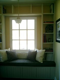 Make a window seat / banquette out of Ikea kitchen cabinets.
