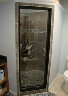 Pebble accent with wood tile