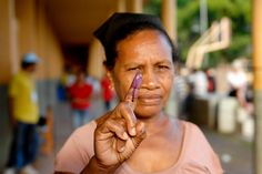 A woman holds up her stained finger after voting today in Timor-Leste's presidential run-off poll, which follows the first round of voting held on 17 March. Photo ID 510220. 16/04/2012. Timor-Leste. UN Photo/Bernardino Soares. www.unmultimedia.org/photo/