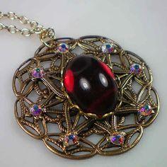Anne Boleyn ruby snowflake necklace.