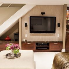 Under stairs ideas and storage solutions under stairs tv for Tv showcase designs under staircase