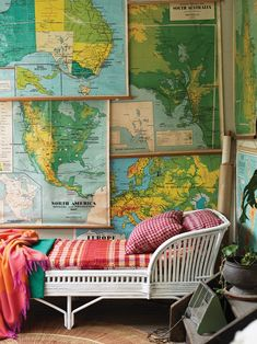 Makes me feel like I am on a jungle trek or safari - with the use of the maps as wall decoration and the fabrics.