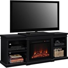 """Bowery Hill 66"""" Fireplace TV Stand in Black. Add this modern Altra 70"""" Fireplace TV Console with Side Shelves to your home and create a beautiful focal point in your room. Warm up with the 6 different heat settings ranging from 72°to 82°. Enjoy your fireplace no matter the weather with the same ambiance of the flame, with or without the heat. The 23"""" fireplace insert warms rooms up to 400 sq. ft. The LED light source boast up to 50,000 hours of life. This TV Console holds up to a 70"""" flat..."""