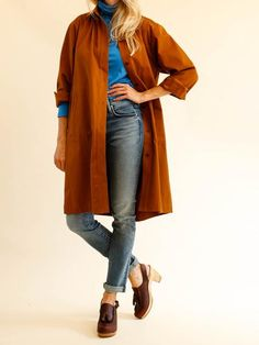 Classic smock dress is a great layering piece for fall. Button closure down…
