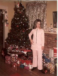This was taken during the early 1970's. Big hair and knit pant suits!