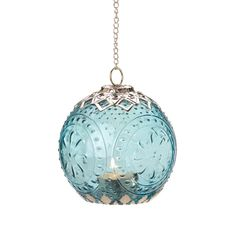 Product Description International design comes home with this beautifully detailed hanging candle lantern. Sea color glass imprinted with a timeless pattern is framed perfectly by intricate filigree,