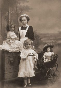 Nursery maid with two children. The woman looks alittle creepy, with her pale face. I wonder if experience with kids is needed to become a nurse maid?