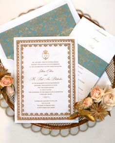 The couple's monogram appeared inside a crest with a coat of arms inspired by Marie Antoinette. Its border was borrowed from a box of Laduree macarons from Paris, and the teal-and-gold envelope liner echoed the pattern on the bottle of St-Germain elderflower liqueur, which was used in a signature drink. Each guest also received accommodation information, an itinerary, and a reply card, bound with a matching paper sleeve (papelpress.com).