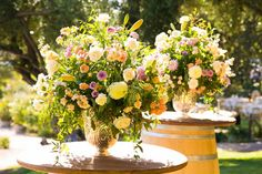 Lush + bright flower arrangements for wedding ceremony altar decor - lilies, roses, chrysanthemums, and stock {A. Blake Photography}