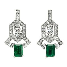 BOUCHERONSet with a pair of Colombian emeralds weighing approximately 4.00cts, and 64 colorless round brilliant cut diamonds weighing approximately 4.06cts. Modern