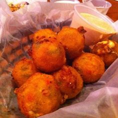 Texas Roadhouse Rattlesnake Bites Recipe red bell pepper, corn muffin mix, corn kernel, butter milk, jalapeno ,cheddar cheese  dip in south west ranch ( 1 T chili powder in 1 cup ranch)