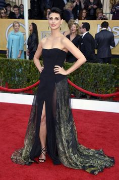 Gorgeous Red Carpet Looks / Morena Baccarins strapless Basil Soda gown showcased her toned arms with a dash of a sexy leg action. She pleted her SAG Awards style with strappy black sandals and jade drop earrings by Jacob  Co.#SAGAwards |Black Heels|