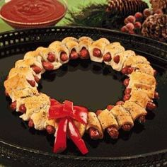 """Pigs-in-a-blanket Wreath This would be something """"cute"""" to take to your office during the Holidays ahead... Ingredients  1 (8-ounce) can original crescent dough  1/4 cup Dijon mustard  20 mini hot dogs or cocktail franks  1 egg, lightly beaten  Poppy seeds or sesame seeds  Tangy Dipping Sauce, recipe follows  Directions  Preheat the oven to 350 degrees F.  Put each triangle of crescent roll dough into thirds lengthwise, making 3 small strips from each roll."""