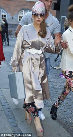 Outfit change: Gaga later swapped her all-black ensemble for an oyster pink kimono and matching head scarf