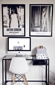 black and white workspace and large posters