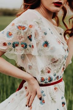 A scattering of floral embroidery and delicate flutter sleeves make this fit-and-flare gown a bohemian dream. Choose from timeless ivory embroidery or a rainbow of colorful blooms. Flower Dresses, Pretty Dresses, Prom Dresses, Cotton Wedding Dresses, Colored Wedding Dresses, Boho Wedding, Floral Wedding Gown, Bohemian Weddings, Bohemian Bride