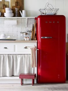"Generally speaking, vintage (and vintage-inspired) appliances have a smaller footprint than modern-day behemoths. They can also add decorative charm—and a welcome pop of color!—in a small space. This 50s-style Smeg refrigerator is just under 24"" wide (compared to the 36"" width of many standard modern models)."
