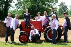 What a great place to take a picture with the groomsmen-1947 American Earthmaster tractor is one of our many FREE props at Fairview Farm.  www.fairviewfarmevents.com