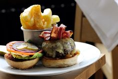The Toms kitchen classic burger with cheese  bacon.