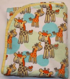Check out this item in my Etsy shop https://www.etsy.com/listing/221932528/giraffe-flannel-yellow-minky-baby