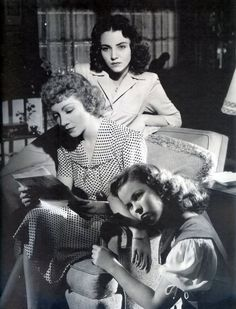 Claudette Colbert, Jennifer Jones, and Shirley Temple read letters in Since You Went Away (1944).