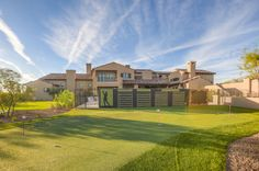 A putting green and batting cages provide fantastic outdoor amenities for this ranch hacienda located in Silverleaf.  Silverleaf Home Sports Premium Outdoor Living Space  Architect: C.P. Drewett, AIA, NCARB Drewett Works, Scottsdale, AZ