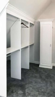 Closet Works: Sloped ceiling master walk in closet design with glass inserts and fold down ironing board. Attic Bedroom Closets, Attic Bedroom Storage, Attic Master Bedroom, Attic Bedroom Designs, Attic Closet, Loft Storage, Attic Wardrobe, Bedroom Closet Design, Upstairs Bedroom