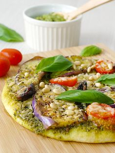 Vegetarian Pesto Pizza Pizzas are one of the easiest food to make in the kitchen, only when you are not making the crust from scratch hehe (ok, one day I shall learn to make my own pizza base). As usual, I cheated with ready-made pizza bases. Since the bulk of the work is taken away with my cheat,
