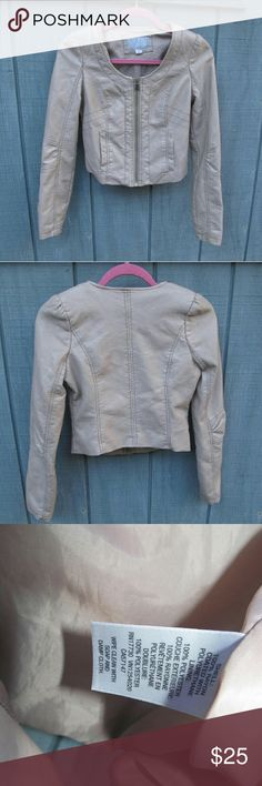 Xhilaration Nude Moto Crop Jacket Well loved super cute & trendy jacket!  Condition is great! Faux Leather has a little wear but no flaws! (See photos) Exact materials are shown in last photo  ?2 front pockets ?Zipper ?Crop style ? Size small petite ?More of a nude color with a hint of pink Xhilaration Jackets & Coats