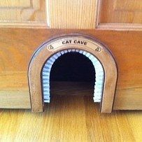 Hole in small door under the stairs for hiding kitty litter...........The cat cave/cat hole/cat door. | 23 Insanely Clever Products Every Cat Owner Will Want