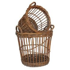 Two handled baskets.   Product: Small and large basketConstruction Material: WillowColor: BrownDimensions: Small: 11.1 H x 13.1 Diameter Large: 13.5 H x 17.3 Diameter