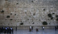 In accordance with Jewish tradition, Pope Francis bowed his head and left a note calling for peace in the crack of the wall which is the holiest site in Judaism. #PopeinHolyLand 26 May 2014