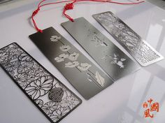 Etched steel bookmarks - the two in the middle are Mirage Bookmarks