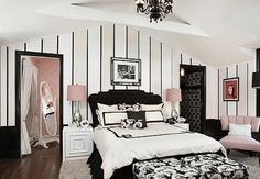 Pink, black and white bedroom. Striped walls