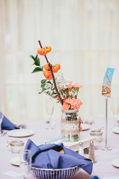 pumpkin tree, orange carnations, mason jar, books: wedding centerpiece. Photo Credit: We Are Diamond Eyes Photography.