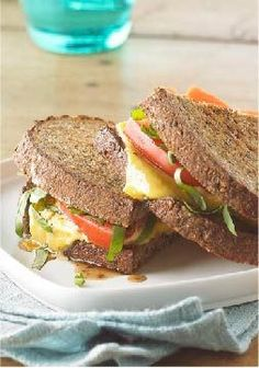 Bruschetta-Style Grilled Cheese Sandwich -- Sliced tomato, fresh basil and a drizzle of balsamic vinaigrette give this healthy living recipe its bruschetta style. Serve with a mixed green salad and fruit for lunch today!