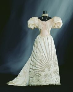 8. Art Noveau: This is an evening dress from c. 1894 designed by Charles Frederick Worth. It is made of ivory silk satin and silk chiffon decoration. The art noveau was a period of revolt against classical art of the Victorian period. Artists like Worth used designs with curved lines that create a sense of movement. Asymmetry was used like in the pattern of the skirt.