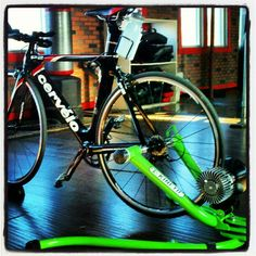We are having fun training on this! Kinetic Bike Trainer with a Cervelo Tri Bike.