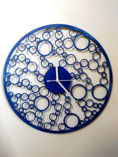 Unique Wooden wall clock. - Diameter 40cm ( 15.74 Inch) - Material: wood 3mm - AA battery, not included - painted with high-quality blue paint.