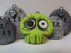 polymer clay zombie skull ornament.