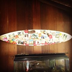 Use an old surfboard and create a beach house collage.