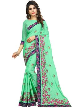 Explore the collection of beautifully designed sarees from Ladysethnic on Zinnga. Each piece is elegantly crafted and will surely add to your wardrobe. Pair this piece with heels or flats for a graceful look. Blouse Patterns, Saree Blouse Designs, Indian Sarees, Pakistani Dresses, Seafoam Color, Women Clothing Stores Online, Green Suit, Embroidery Saree, Green Saree