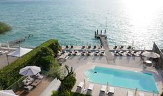 Lago di Garda, Italy's biggest lake has always shimmered brightly, luring classic Roman poets, Italian aristos and Hollywood elite for time immemorial. Perched on its lakeside is an original 1930s white villa, now cleverly reimagined for the nomads of the modernist style. With the feel of a hip in-the-know club for lido-lovers, AQVA Boutique Hotel's modular alabaster-white building is fronted by a turquoise pool surrounded by sleek decking and a private pier jutting out onto the lake. Big Lake, White Building, Hotel S, How To Know, Dna, Garda Italy, Villa, Boutique