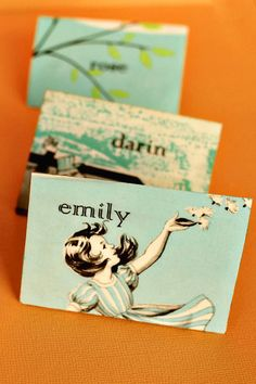 Create place cards using illustrations from vintage children's books.      Glue magnets on the back so guests can take them home as keepsakes.